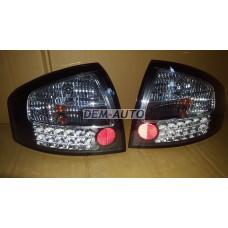 Audi a6  Фонарь задний внешний левый+правый (КОМПЛЕКТ) тюнинг (СЕДАН) прозрачный с диодным стоп сигналом (SONAR) внутри черно-хромированный - Dem-Yug